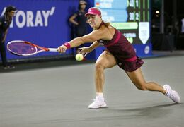 Angelique Kerber of Germany returns a shot to Elina Svitolina of Ukraine during their second round match of the Japan Pan Pacific Open tennis tournament in Tokyo Wednesday, Sept. 17, 2014. (AP Photo/Shizuo Kambayashi)