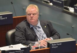 Toronto Mayor Rob Ford sits during a City council meeting at Toronto City Hall on Tuesday May 21, 2013. Toronto's deputy mayor says it's unfortunate that the city is finding itself the butt of jokes on late night U.S. talk shows over the latest Rob Ford scandal.THE CANADIAN PRESS/Nathan Denette