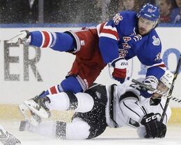 New York Rangers right wing Mats Zuccarello (36) hits the ice with Los Angeles Kings right wing Dustin Brown (23) in the second period during Game 4 of the NHL hockey Stanley Cup Final, Wednesday, June 11, 2014, in New York. THE CANADIAN PRESS/AP/Kathy Willens