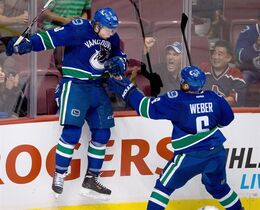 Vancouver Canucks' Hunter Shinkaruk, left, celebrates his goal during a pre-season NHL game in Vancouver, on September 16, 2013. THE CANADIAN PRESS/Darryl Dyck