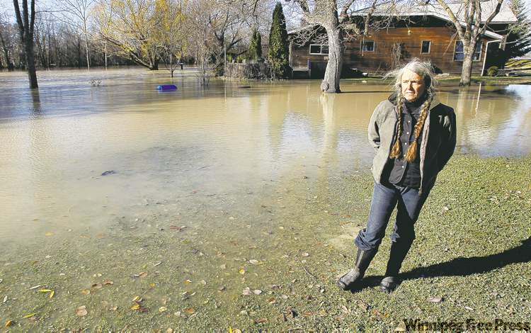 Ann Cook and her flooded property at Stephenson Point.