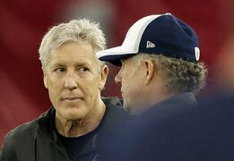 Seattle Seahawks head coach Pete Carroll, left, talks with quarterbacks coach Carl Smith during a team practice for NFL Super Bowl XLIX football game, Friday, Jan. 30, 2015, in Tempe, Ariz. The Seahawks play the New England Patriots in Super Bowl XLIX on Sunday, Feb. 1, 2015. (AP Photo/Matt York)