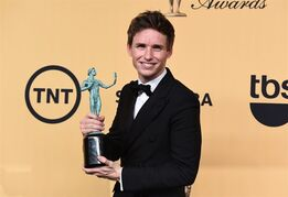 "Eddie Redmayne poses in the press room with the award for outstanding performance by a male actor in a leading role for ""The Theory of Everything"" at the 21st annual Screen Actors Guild Awards at the Shrine Auditorium on Sunday, Jan. 25, 2015, in Los Angeles. (Photo by Jordan Strauss/Invision/AP)"