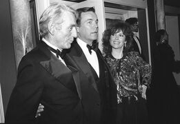 FILE - In this Feb. 18, 1985 file photo, Jill St. John, right, with Robert Wagner, center, and Rod McKuen, left, attend a party for