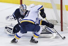 St. Louis Blues' Alexander Steen (20) scores the game winning goal on Winnipeg Jets goaltender Michael Hutchinson (34) during the shootout in NHL action in Winnipeg on Thursday, February 26, 2015. THE CANADIAN PRESS/John Woods