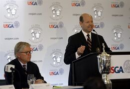 Mike Davis, right, Executive Director of the United States Golf Association, speaks as USGA President Thomas J. O'Toole, left, listens at Pinehurst Resort & Country Club during media day for the upcoming back-to-back U.S. Open and U.S. Women's Open golf championships to be held this June in Pinehurst, N.C., Monday, April 21, 2014. (AP Photo/Gerry Broome)