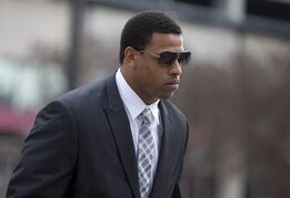 "FILE- In this Feb. 9, 2015, file photo, Carolina Panthers' defensive end Greg Hardy arrives at the Mecklenburg County Courthouse on the first day of his domestic violence appeal trial in Charlotte, N.C. Panthers defensive end and soon-to-be free agent Greg Hardy will be allowed to sign a new contract even if he remains on the commissioner's exempt list. League spokesman Greg Aiello said Thursday, March 5, 2015, in an email to The Associated Press, ""There's nothing to prevent a player on the Exempt list without a contract from signing a new one. (AP Photo/Chris Keane, File)"