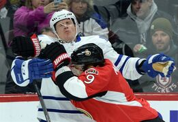 Ottawa Senators' Milan Michalek hits Toronto Maple Leafs' Dion Phaneuf during first period NHL hockey action in Ottawa on Wednesday, Jan 21, 2015. Leafs coach Peter Horachek said Phaneuf is week-to-week with an upper-body injury sustained prior to the all-star break. THE CANADIAN PRESS/Sean Kilpatrick