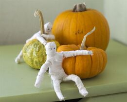 This Sept. 28, 2014 photo shows handmade miniature mummies that can be positioned in a variety of poses and added to Halloween decor, in Concord, N.H. (AP Photo/Holly Ramer)