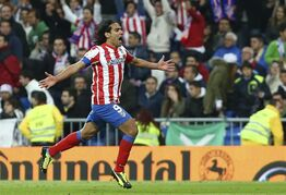 Atletico de Madrid's Radamel Falcao from Colombia, right, celebrates after beating Read Madrid in their Copa del Rey final soccer match at the Santiago Bernabeu stadium in Madrid, Spain, Friday, May 17, 2013. (AP Photo/Andres Kudacki)