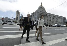 Ellen Pao, right, walks to Civic Center Courthouse in San Francisco, Friday, March 27, 2015. The jury are due back in court on Friday in Pao's lawsuit against Kleiner Perkins Caufield & Byers. Pao says the firm discriminated against her because she was a woman and then retaliated by denying her a promotion and firing her when she complained about gender bias. Kleiner Perkins denies the allegations. (AP Photo/Jeff Chiu)