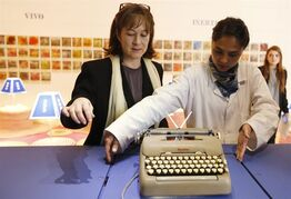 Consuelo Gaitan, left, National Library of Bogota director, and Alejandra Padilla, show the first Smith Corona typewriter owned by the late Nobel Prize-winning novelist Gabriel Garcia Marquez, at the National Library in Bogota, Colombia, Friday, April 17, 2015. The library has on exhibit several personal objects donated by the author's family, including the gold Nobel Prize medal and his first Smith Corona typewriter, off which flew the pages of