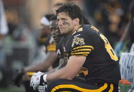 Hamilton Tiger-Cats' Andy Fantuz sits on the bench in Toronto, on June 19, 2013. THE CANADIAN PRESS/Darren Calabrese