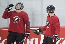 Curtis Lazar, left, laughs with Sam Reinhart during practice at the Team Canada National Junior hockey team summer development camp practice in Brossard, Que., Sunday, August 3, 2014. The Ottawa Senators have decided to let Lazar play for Canada at the world junior championship.Lazar, one of the Senators' top prospects, has recorded a goal and six assists this season as their fourth-line centre. THE CANADIAN PRESS/Graham Hughes