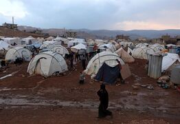 Canada is being called upon to pledge nearly $180 million towards a record-breaking international aid appeal for Syria this year. A Syrian refugee woman walks near the tents of a refugee camp in the eastern Lebanese border town of Arsal in this Monday, Nov. 18, 2013 file photo. THE CANADIAN PRESS/AP-Bilal Hussein, File