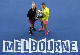Bethanie Mattek-Sands of the U.S., left, and Lucie Safarova of the Czech Republic pose with the trophy during the awarding ceremony, after defeating Taiwan's Chan Yung-jan and China's Zheng Jie in their women's doubles final at the Australian Open tennis championship in Melbourne, Australia, Friday, Jan. 30, 2015. (AP Photo/Lee Jin-man)