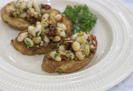 This Nov. 17, 2014 photo shows winter white bean bruschetta in Concord, N.H. In Italy a reliance on delicious whole ingredients and bold flavors means there are plenty of small bites perfect a celebration. (AP Photo/MatthewMead)
