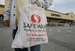 FILE - In this Feb. 23, 2011 file photo, a customer leaves a Safeway store in Cupertino, Calif. Safeway reports quarterly earnings on Wednesday, April 23, 2014. (AP Photo/Paul Sakuma)