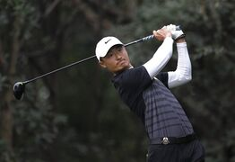 FILE - In this Nov. 9, 2014 file photo, Li Haotong of China tees off on the 11th hole during the final round of the HSBC Champions golf tournament at the Sheshan International Golf Club in Shanghai, China. Li Haotong is one of the most exciting prospects to emerge in recent months. On April 19, 2015, Li came up just short of winning his first European Tour title, falling to Thailand's Kiradech Aphibarnrat in a playoff at the Shenzhen International. The runner-up finish took him to No. 125 in the world rankings, just 19 spots below Tiger Woods. (AP Photo/File)