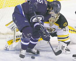 The Winnipeg Jets' Mathieu Perreault (85) attempts the backhander against Boston Bruins goaltender Tuukka Rask (40) during the first period in Winnipeg on Friday.