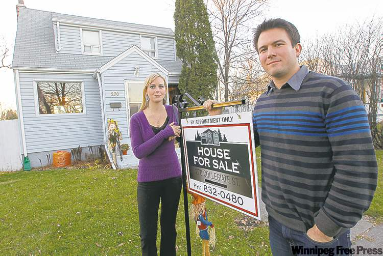 Sandra Carson and husband Stephan stand in front of the Collegiate Street house they're trying to sell.