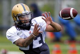 Bombers #73 Justin Veltung reels in a catch during Day 2 of Bombers rookie camp.