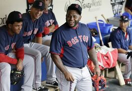 Boston Red Sox third baseman Pablo Sandoval laughs in the dugout during batting practice before a spring training exhibition baseball game against the Atlanta Braves in Kissimmee, Fla., Friday, March 27, 2015. (AP Photo/Carlos Osorio)