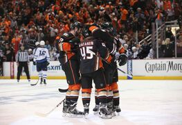 The Anaheim Ducks' Sami Vatanen (45) is lauded by teammates after scoring early in the first period against the Winnipeg Jets during Game 1. The Ducks claimed victory after a reviewed third-period goal by Corey Perry, winning the game 4-2.