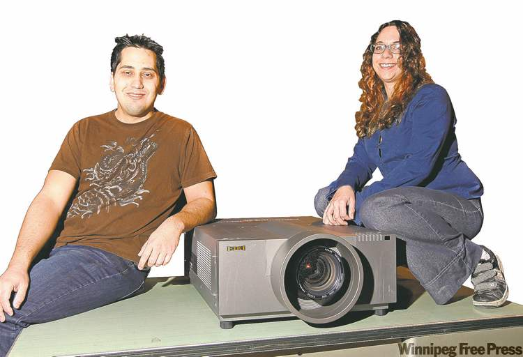 PO-MO's Meghan Athavale and Curtis Wachs with their EIKI projector.