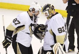 Pittsburgh Penguins' Sidney Crosby congratulates Tomas Vokoun on a 7-3 victory over the Ottawa Senators following NHL playoff action in Ottawa, Wednesday May 22, 2013. THE CANADIAN PRESS/Adrian Wyld