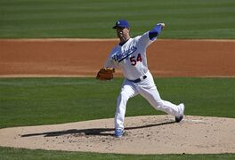 Los Angeles Dodgers' David Huff pitches in the second inning of a spring training exhibition baseball game against the Seattle Mariners Friday, March 6, 2015, in Phoenix. (AP Photo/John Locher)