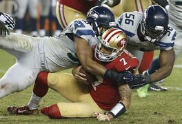 San Francisco 49ers quarterback Colin Kaepernick (7) is sacked by Seattle Seahawks outside linebacker K.J. Wright, left, as defensive end Cliff Avril (56) approaches during the fourth quarter of an NFL football game in Santa Clara, Calif., Thursday, Nov. 27, 2014. The Seahawks won 19-3. (AP Photo/Tony Avelar)