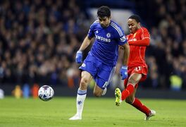 Liverpool's Raheem Sterling, right, challenges Chelsea's Diego Costa for the ball during the English League Cup semifinal second leg soccer match between Chelsea and Liverpool at Stamford Bridge stadium in London, Tuesday, Jan. 27, 2015. (AP Photo/Kirsty Wigglesworth)