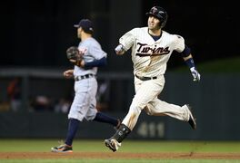 Minnesota Twins' Brian Dozier races to third on an RBI triple off Detroit Tigers pitcher Al Alburquerque in the sixth inning of a baseball game, Wednesday, Sept. 17, 2014, in Minneapolis. The Twins won 8-4. (AP Photo/Jim Mone)