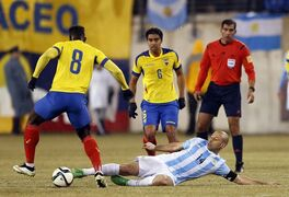 Argentina's Javier Mascherano (14) makes a slide tackle against Ecuador's Felipe Caicedo during the first half of an international soccer friendly, Tuesday, March 31, 2015, in East Rutherford, N.J. (AP Photo/Julio Cortez)