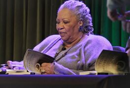 FILE - In this Feb. 27, 2013 file photo, author Toni Morrison signs copies of her latest book