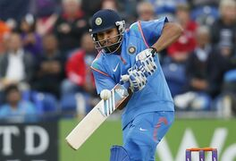 India's Rohit Sharma hits runs off the bowling of England's Chris Jordan during their One Day International cricket match at the SWALEC cricket ground in Cardiff, Wales, Wednesday, Aug. 27, 2014. (AP Photo/Alastair Grant)