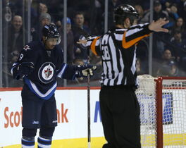 Winnipeg Jets forward Evander Kane looks in disbelief as the referee waves off a goal.