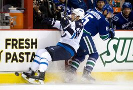 Winnipeg Jets forward Devin Setoguchi (left) and Brad Richardson of the Vancouver Canucks collide during the first period of Sunday's game.