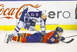 Winnipeg's Olli Jokinen trips over Florida's Scottie Upshall Thursday.