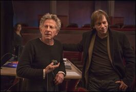 FILE - This photo released by IFC Films shows director Roman Polanski, left, and Mathieu Amalric as Thomas behind the scenes in Polanski's film,
