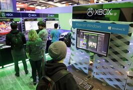 People look over an Xbox on Windows display in the Microsoft booth at the Game Developers Conference, Wednesday, March 4, 2015, in San Francisco. (AP Photo/Eric Risberg)