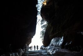 People explore an ice cave at the Apostle Islands National Lakeshore on Lake Superior, Friday, Feb. 27, 2015, near Bayfield, Wis. (Zbigniew Bzdak/Chicago Tribune)
