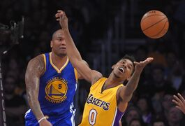 Los Angeles Lakers forward Nick Young, reaches for rebound as Golden State Warriors forward Marreese Speights looks on during the first half of an NBA basketball game, Tuesday, Dec. 23, 2014, in Los Angeles. (AP Photo/Mark J. Terrill)