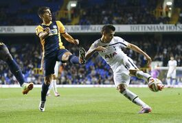Tottenham's Erik Lamela, right, scores his second goal during the Europa League Group C soccer match between Totteham Hotspur and Asteras Tripolis at White Hart Lane stadium in London, Thursday, Oct. 23, 2014. (AP Photo/Kirsty Wigglesworth)