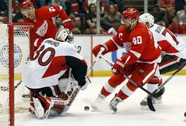 Ottawa Senators goalie Andrew Hammond (30) stops a shot by Detroit Red Wings left wing Henrik Zetterberg (40) in the second period of an NHL hockey game in Detroit Tuesday, March 31, 2015. (AP Photo/Paul Sancya)