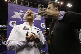 Seattle Seahawks' Jon Ryan is interviewed during media day for NFL Super Bowl XLIX football game Tuesday, Jan. 27, 2015, in Phoenix. (AP Photo/Mark Humphrey)