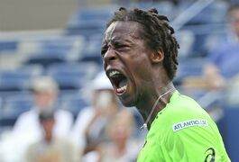 Gael Monfils, of France, reacts after a shot against Grigor Dimitrov, of Bulgaria, during the fourth round of the 2014 U.S. Open tennis tournament, Tuesday, Sept. 2, 2014, in New York. (AP Photo/Mike Groll)