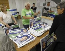 Volunteers at Brian Bowman's campaign office get his signs ready for distribution tomorrow.
