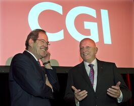 CGI Chairman Serge Godin, left, and chief executive Michael Roach get set to start the company's annual meeting Wednesday, January 28, 2015 in Montreal. THE CANADIAN PRESS/Ryan Remiorz